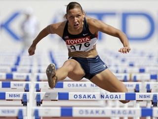 Lolo Jones clears the hurdles during the World Championships in Osaka.