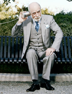 photo of vint cerf sitting on bench with tin can to ear