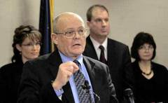 Department of Natural Resources commissioner Tom Irwin, front, answers questions at a news conference Friday, Jan. 4, 2008, after Gov. Sarah Palin announced that the TransCanada application submitted under the Alaska Gasline Inducement Act met all the requirements.