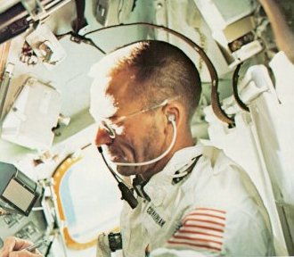 A photo of Cunningham, lunar module pilot on Apollo 7 making notes