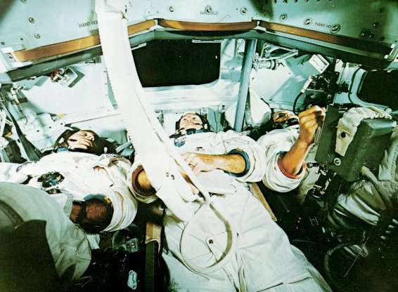 A photo of Apollo astronauts,Anders,Lovell, and Borman inside a simulator