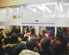 Photograph of crowd outside a Walmart store on Long Island, shortly before someone was trampled to death on Black Friday 2008, via archive.org