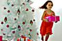 Generic little girl running away from Christmas tree with a present.