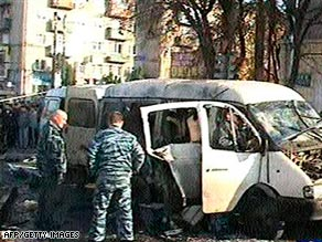 Police investigate the cause of the bomb blast in North Ossetia, which killed 12 people Thursday.