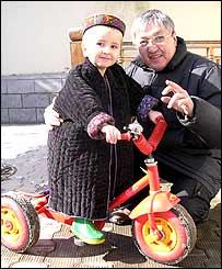 Office driver Alimkhodja Nuritdinov with Monica's son Anvar, aged three