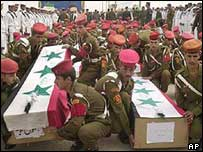 Iraqi soldiers return remains of fallen Iranians at border ceremony, 2002