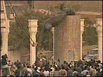 A bronze statue of Saddam Hussein is pulled down in central Baghdad after US forces enter the city
