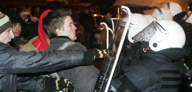 Riot police clash with protesters in Riga, Latvia