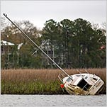 Boats Too Costly to Keep Are Littering Coastlines