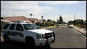 A police vehicle parked in front of a house that has been cordoned off by police, Phoenix, Arizona