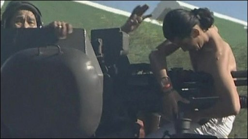 Close-up of protester on armoured vehicle