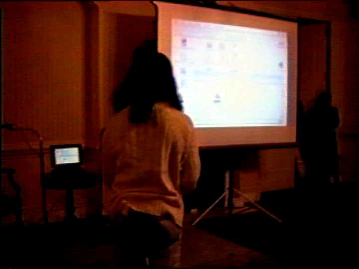Begos's laptop and big screen at front of Americas Society room