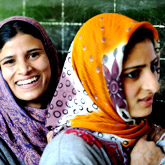 Young Kashmiri women wait for their turn to cast their votes in Mahawara village in the central Kashmiri district of Budgam. Indian Kashmir voted under tight security amid a crippling strike by separatists and fresh boycott calls from hardline rebels in the fourth of five phases in India?s parliamentary elections.