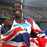 Christine Ohuruogu of Great Britain celebrates winning the gold medal in the Women's 400m Final at the National Stadium