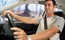 Young man in driving seat of car - Young drivers left in limbo by insurers