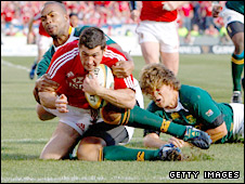 Rob Kearney goes over for the opening try in the second Test