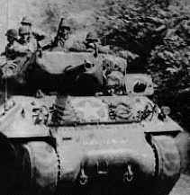 US Infantry riding on M10 Tank Destroyer