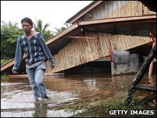A man inspects damage in Padang