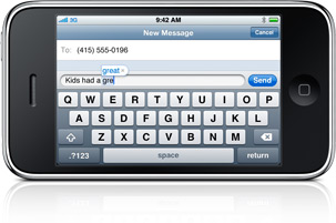 The iPhone keyboard in landscape, typing a message.