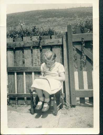 Me,  reading 'Jack & Jill' in the garden, very near to where the picture above was taken