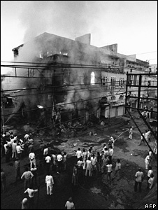 Sikh owned shops sit on fire during the riots in 1984