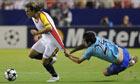 Unirea's defender Vasile Maftei clings on as Sevilla's Diego Capel speeds past him