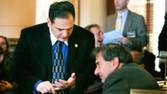 [New Jersey Sen. Nicholas Scutari, left, discusses his medical-marijuana bill with Sen. Gerald Cardinale in February.]