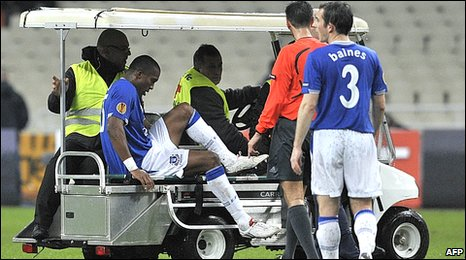 Everton defender Sylvain Distin is carted off