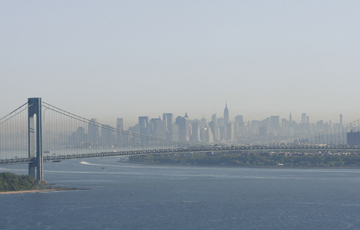 A layer of smog can be seen above Manhattan through the Verrazano-Narrows Bridge in New York on May 21, 2009.