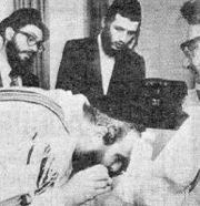 A Jew passing on herpes to a Jew-larva.