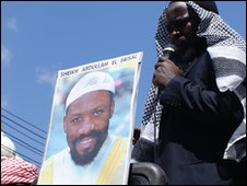 Protester with portrait of Abdullah al-Faisal