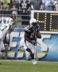 Jets Chargers Football - LaDainian Tomlinson, Bart Scott
