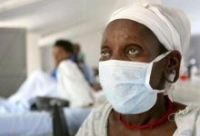 A patient who tested positive for extreme drug resistant tuberculosis (XDR-TB) awaits treatment at a rural hospital at Tugela Ferry in South Africa's impoverished KwaZulu Natal province, in this photo taken October 28, 2006. REUTERS/Mike Hutchings/Files