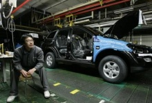 A Ssangyong Motor worker sits beside the company's assembly line, which has been stopped, at its factory in Pyeongtaek, about 70 km (40 miles) south of Seoul, in this January 12, 2009 file photo. Seemingly effortlessly, China has amassed the world's biggest stockpile of foreign exchange reserves, is overtaking Germany as the biggest exporting nation and now has a car market bigger than America's.  REUTERS/Jo Yong-Hak/Files