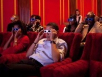 President Obama and First Lady Michelle Obama wear 3-D glasses while watching the Super Bowl game