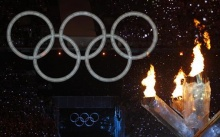The Olympic flame burns near the Olympic Rings during the opening ceremony of the Vancouver 2010 Winter Olympics, February 12, 2010. REUTERS/Mike Blake