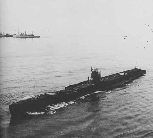 Ex-German U-boat U-117 [foreground], US Destroyer Bsrney (no. 149) and US Minesweeper Rail (No. 26) [background]. The U-117 was bombed on 21 June 1921 by Navy planes.