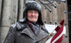 A Latvian Legion veteran at the Monument of Freedom as part of an annual commemoration in Riga.