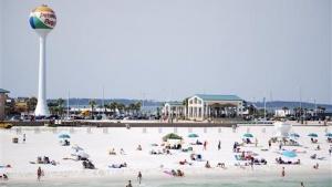 Bathers relax on Pensacola Beach, Florida June 25, 2008. REUTERS/Matthew Bigg