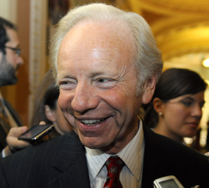 Joe Lieberman, shown outside the Senate Democrats' weekly policy lunch in Washington in December, is one of the senators behind a proposed act that would strip suspected terrorists of their U.S. citizenship.