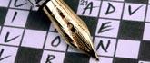 crossword with Cross fountain pen.