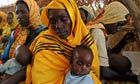 Malnourished children are fed at the Mornay camp, in western Darfur, Sudan