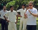 Steve Waugh talks to aspiring cricketers during a coaching camp, New Delhi, India
