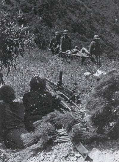 Medics evacuate wounded of the 5th Regimental Combat Team hit near Masan, 30 August, 1950.