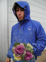 Our summer intern Jeff with a beautiful bouquet of kale.