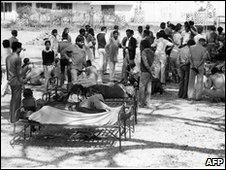 In a file picture taken on December 4, 1984, blinded victims of the Bhopal tragedy sit in the street and wait to be treated at Bhopal hospital after a deadly poisonous gas leak from the Union Carbide factory.