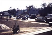 Vendors and salesman lined up along Jasmine Road in the Juniper Hill section. [Courtesy of George Carmichael.]
