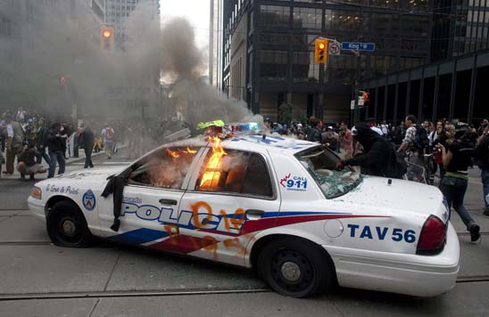 A police car burns after G20 summit protesters set fire to it in downtown Toronto on Saturday.