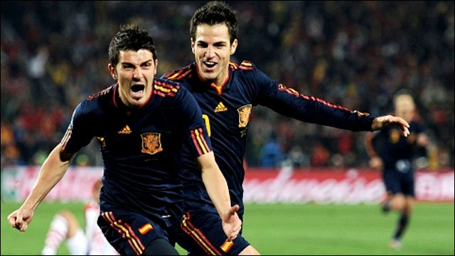 David Villa and Cesc Fabregas celebrate for Spain
