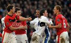 Leeds United's Jonny Howson confronts Manchester United's Wes Brown during their FA Cup match.